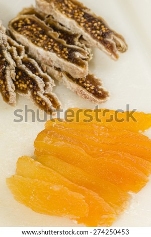 Ingredients for preparation of artisanal chocolate bar with dried fruits - stock photo