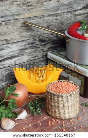Ingredients for pumpkin - lentils soup on wooden background - stock photo