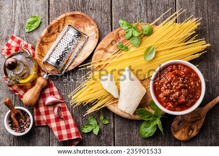 Ingredients for spaghetti bolognese on gray wooden background - stock photo