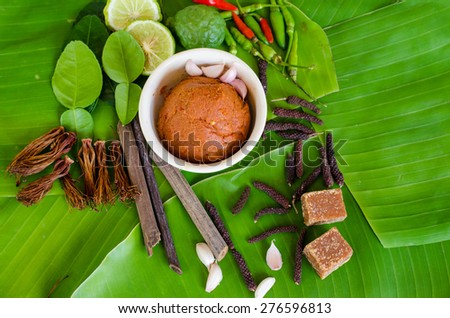 Ingredients for spicy Thai soup Tom Yam with chili pepper and lemon grass on green leaf background - stock photo