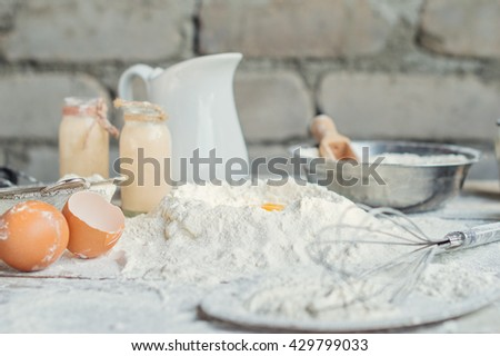ingredients for the dough - flour, egg, cream, fermented baked milk, kitchen equipment, rustic style - stock photo