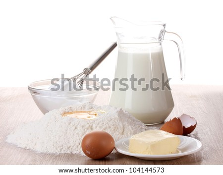 Ingredients for the dough wooden table on white background - stock photo