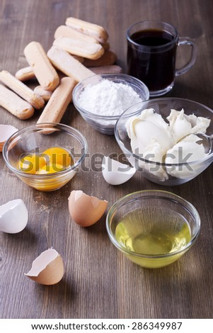 Ingredients for the Italian dessert of Tiramisu on a wooden table - stock photo