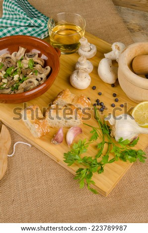 Ingredients needed to cook a delicious mushroom tapa - stock photo