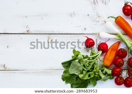 Ingredients of Fresh vegetable salad on white wooden background. Healthy or vegetarian eating concept. - stock photo