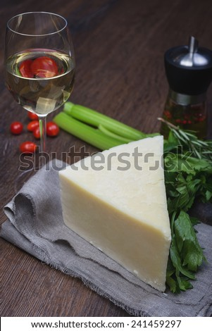 Ingredients of italian cuisine  - cherry tomato, basil, piece of parmesan and olive oil on wooden table - stock photo