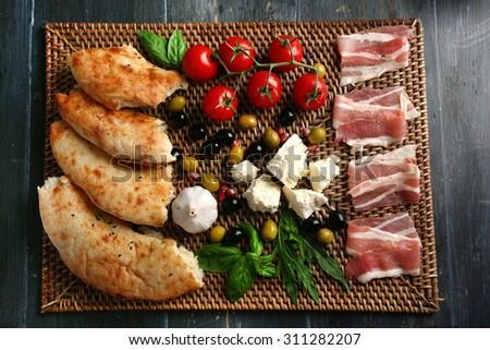 Ingredients of Mediterranean cuisine, on wooden board, top view - stock photo