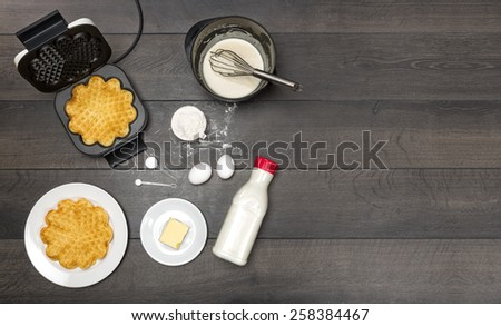 Ingredients, preparation and serving of waffles. All ingredients needed for waffles. Copy space included. - stock photo
