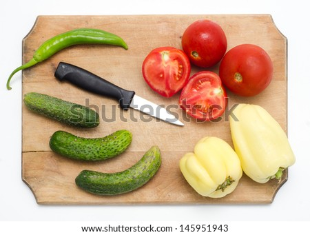 Ingredients ready for cooking on a wooden board - stock photo