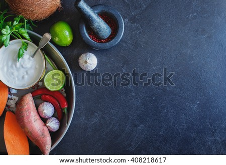 Ingredients to prepare Thai coconut creamy soup. Healthy and fresh vegetables on stone background. - stock photo