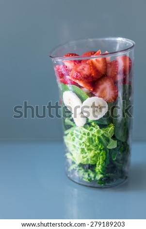 Ingridients for a healthy green smoothie, healthy combo mix drink with kale, strawberries and banana - stock photo