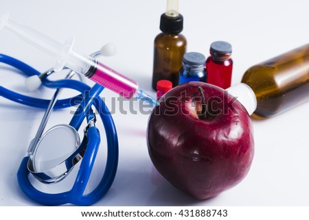 injecting dangerous substances on food. Concept for genetically modified foods. - stock photo