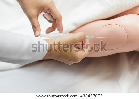Injection doll patient for education - stock photo