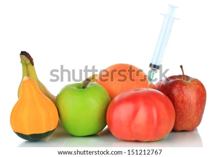 Injection into fresh red tomato isolated on white - stock photo