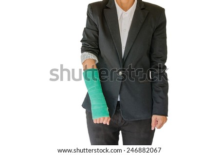 Injured businesswoman with green cast on hand and arm on white background - stock photo