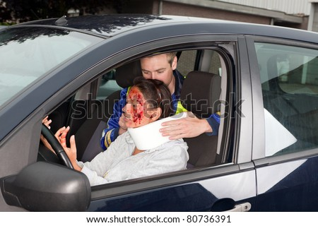 Injured woman in car crash getting a whiplash neck brace - stock photo
