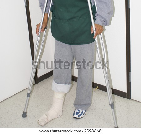 Injured Worker, disabled on the job, safety concepts, medical patient, broken leg - stock photo