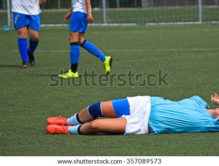 Injury on the women's soccer match - stock photo
