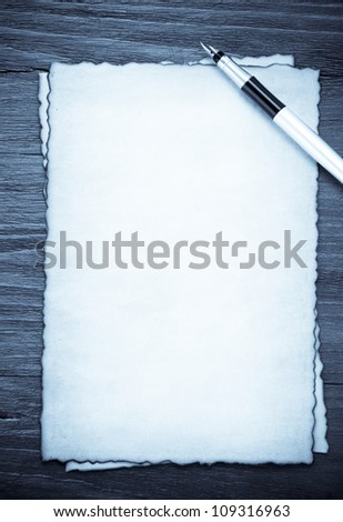 ink pen on parchment background texture - stock photo