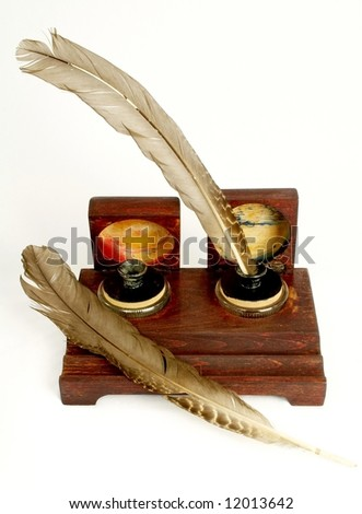 Ink pot with two quills - stock photo