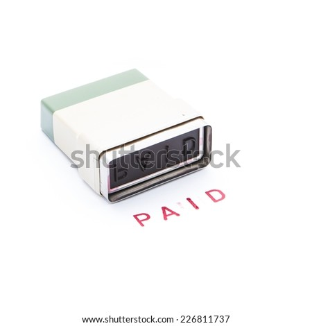 Ink stamp paid on white background - stock photo