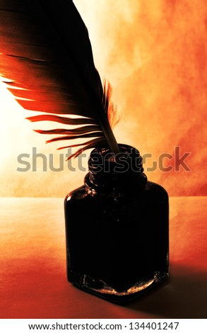 inkwell and pen feather, retro style - stock photo