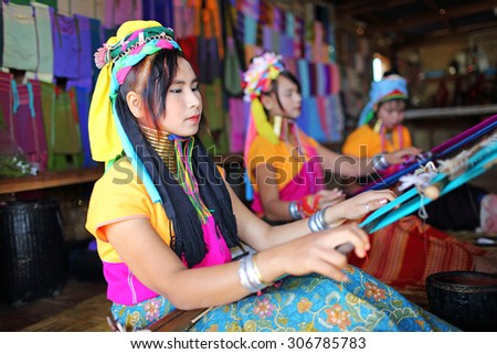 INLE LAKE, MYANMAR - DEC 8: Unidentified Padaung tribe long-necked tribe woman for a portrait on Dec 8, 2014 and wearing the traditional metal rings around her  - stock photo