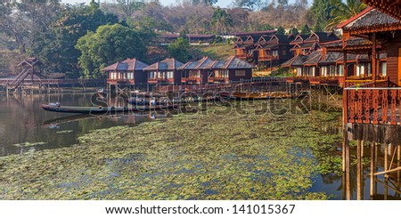 INLE LAKE, MYANMAR - FEBRUARY 28: Replica of the traditional floating village engineered as a hotel with bungalows on February 28, 2013 in Inle Lake, Myanmar. - stock photo