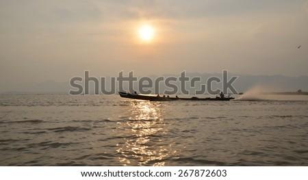 Inle Lake, Myanmar. Fishing boat returns at sunset - stock photo