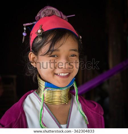INLE LAKE, MYANMAR - JANUARY 12, 2016: Padaung Tribal woman poses for a photo in Inle lake, Myanmar, Burma The Padaung-Karen long-necked tribe women are minority of Myanmar. - stock photo
