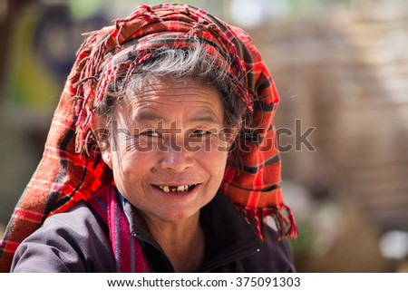 INLE LAKE, MYANMAR - JANUARY 12, 2016: Unidentified old woman on her smile face is happiness. The local people are hospitable and friendly to tourists - stock photo