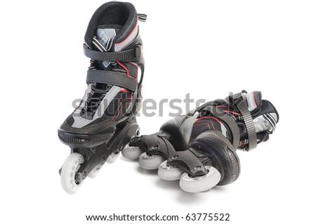 Inline skates isolated over white - stock photo