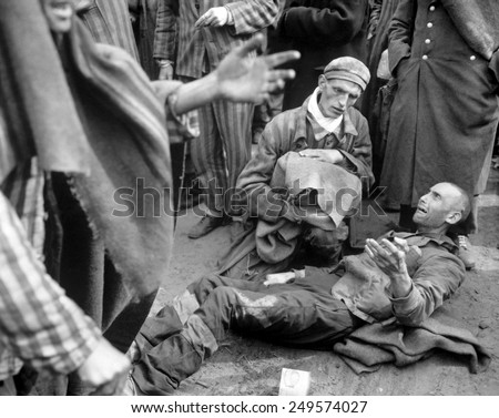 Inmates of Wobbelin concentration camp awaiting transport to the hospital. One breaks into tears when he learns he is not leaving with the first group. May 4, 1945, Germany, World War 2. - stock photo