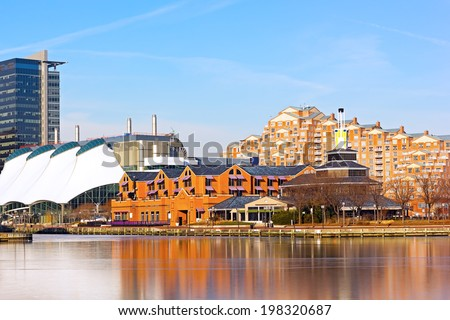 Inner Harbor of Baltimore in winter. Concert Pavilion and commercial buildings along the pier. - stock photo
