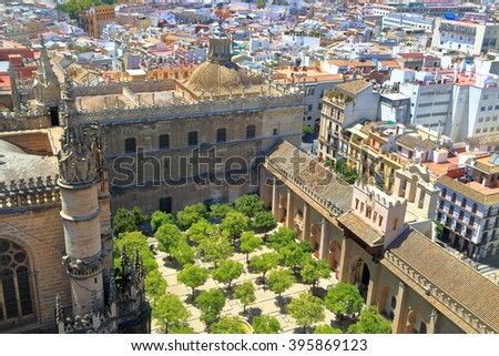 Inner patio with orange trees of the Cathedral of Saint Mary of the See (Seville Cathedral) in Seville, Andalusia, Spain - stock photo
