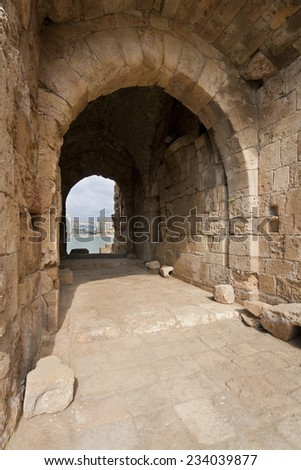 Inner yard and arch of old castle in Saida, Lebanon, was build in XIII century by crusaders - stock photo