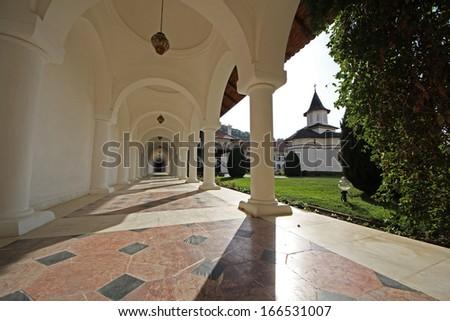 Inner yard corridor of Brancoveanu monastery in Sambata, Romania - stock photo