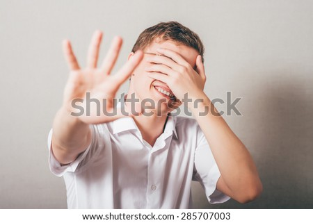 Innocent Man showing stop. one hand showing the stop, the other closes his eyes - stock photo