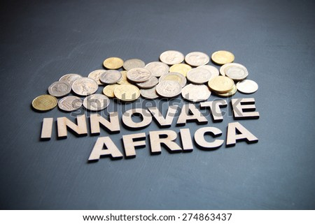 Innovate Africa concept written with wooden letters on blackboard. This photo can use as Business background.  - stock photo