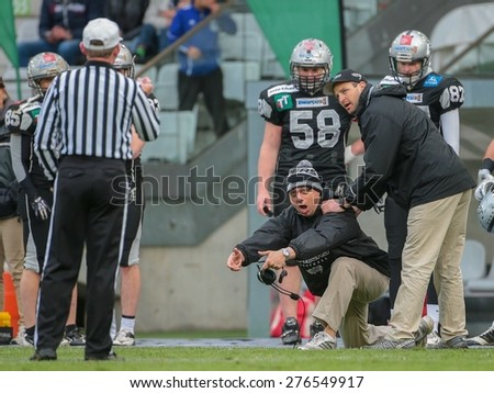 INNSBRUCK, AUSTRIA - MAY 3, 2014: Head Coach Shuan Fatah (Raiders) disagrees with the spotting of the ball. - stock photo