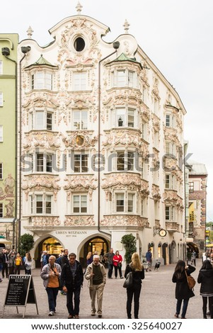 INNSBRUCK, AUSTRIA - SEPTEMBER 22: Tourists at the Helbinghaus in Innsbruck, Austria on September 22, 2015. Innsbruck is the capital of Tyrol.  - stock photo