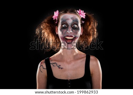 insane funny female clown in front of black - stock photo