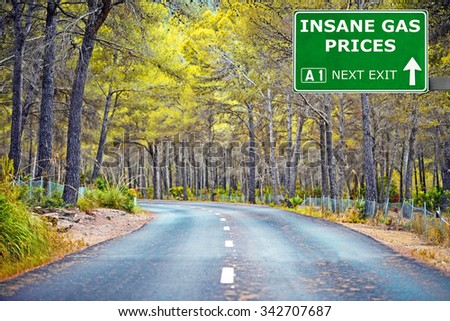 INSANE GAS PRICES road sign against clear blue sky - stock photo