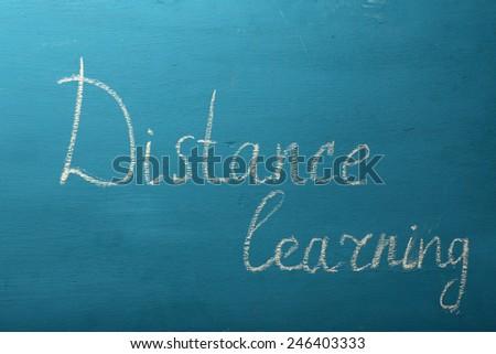 Inscription Distance Learning on blackboard background - stock photo