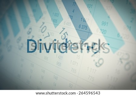 """Inscription """"Dividends"""" on screen. Financial data visible on background. - stock photo"""