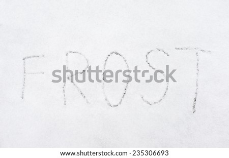 inscription frost on snow-covered ice, the inscription on the snow - stock photo