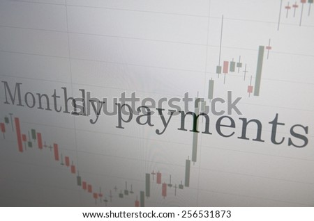 """Inscription """"Monthly payments"""" on PC screen. Financial concept. - stock photo"""