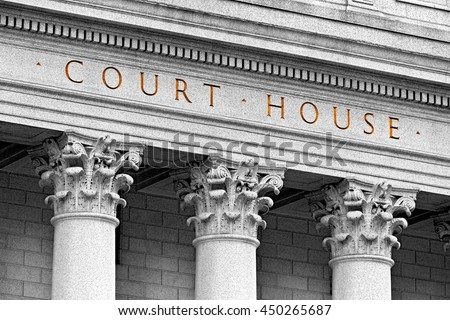 inscription on the courthouse close-up - stock photo