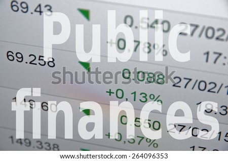 Inscription Public finances on PC screen. The financial data visible in the background.  - stock photo