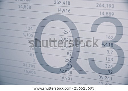 """Inscription """"Q3"""" on PC screen. Financial data on background. - stock photo"""